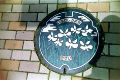 Another manhole cover in Inawashiro machi (photo AN)