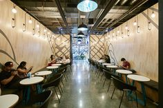 Industrial lighting with WOW pendant lights - Dovetail Design Group Retail Interior Design