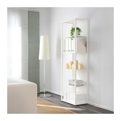"FJÄLKINGE Shelf unit, white  Width: 22 7/8 "" (58 cm)  Depth: 13 3/4 "" (35 cm)  Height: 76 "" (193 cm) http://www.ikea.com/us/en/catalog/products/50221688/"
