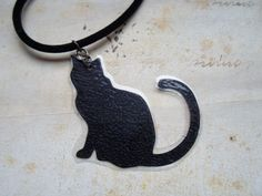 Lightweight necklace with black cat silhouette, made from paper, hanging on round velvet cord. Surface treated with lamination. Black Cat Silhouette, Cats, Gatos, Cat, Kitty, Kitty Cats