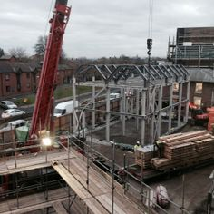 The crane moving the oak for the on site team to erect.