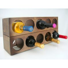 This Rutherford wine rack includes two racks which will hold a total of ten wine bottles. These wine racks are stackable or wall-mountable to stylishly optimize space in your kitchen or dinning area.