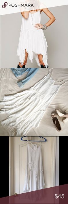 """Intimately Free People Tattered Up White Dress Intimately Free People • Size small • Style is called """"tattered up"""" slip dress • Entirely white w/ frayed stitching on the skirt and frayed hems • Adjustable spaghetti straps • V shaped neckline • Racerback • In excellent condition—has a few tiny marks on the skirt & a very small round mark on the top (shown in photos). Other than that, no holes or damage • Measurements: Bust: 32"""" circumference. Waist: 36"""" circumference. Length (armpit to…"""