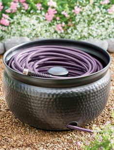 Our Hammered Hose Pot is designed with a center stem to help ease hose winding and storage, and prevent tangling. Pot also features an inlet port to easily connect the hose to your water supply without removing from pot. Holds up to 100 ft. of coiled garden hose. Garden Hose Storage, Metal Garden Hose, Garden Oasis, Lawn And Garden, Garden Pots, Wicker Swivel Chair, Outdoor Wall Clocks, Boxwood Garden, Lawn Sign