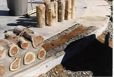 "cordwood construction - how it's done. 15-18"" thick walls, great insulating value."