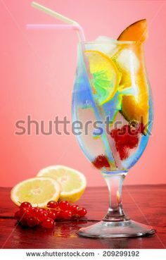 iced fruit #cocktail over #pink background - stock photo