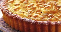 La ricetta di una torta facile e veloce, raffinata e molto golosa, la torta al limone e pinoli, una vera delizia