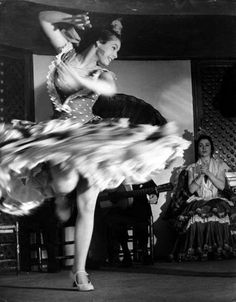 I love the motion captured and blurred as well as the placement of the highlights on the dancer and the lower values in the background emphasizing her. (Brassai)