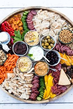 Epic Greek Charcuterie Board filled with hummus veggies dried fruit and nuts cheese cured meats pita bread and delicious Tzatziki sauce Charcuterie Recipes, Charcuterie And Cheese Board, Charcuterie Platter, Hummus Platter, Cheese Boards, Crudite Platter Ideas, Snack Platter, Antipasto Platter, Meat Appetizers