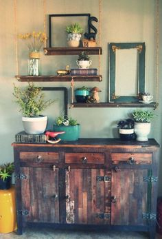 "I like all of the many ideas in this picture.the hanging shelves, the repurposed cabinet, the plants in unexpected little ""pots"". My Home Design, House Design, Interior Flat, Plantas Indoor, Hanging Rope Shelves, Deco Buffet, Happy Earth, Shabby Chic, Interiores Design"
