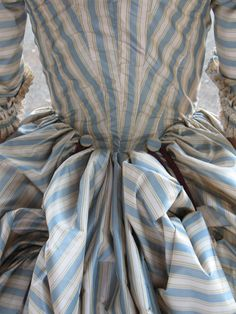 Early 1800's - Love the detail. Skirt train gets hooked onto buttons for easier walking or dancing