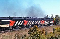 Five-pack of speeding, smoking, thundering, water-sloshing MLW FPA-4s CN6770, 6793, 6780, 6779, 6767. Toronto Ontario c1978