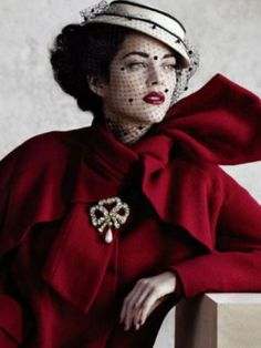 Marion Cotillard wearing Dior in 'Dior Bombshells' video campaign. What a gorgeous red coat!