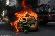 Firefighter fighting a car fire ~ Re-pinned by Crossed Irons Fitness