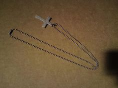 Unusual hand made an alloy metal cross pendant possibly World War trench art