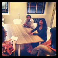 Raj, Ash & Anu founders of Appguppy practicing their pitch with Martha Denton.