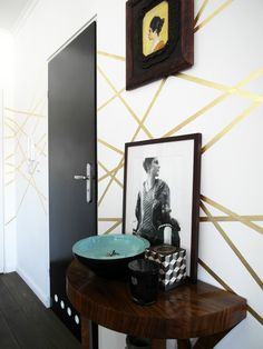 gold leaf stripes...perfect upgrading idea for a simple white wall