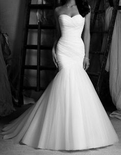 black and white photo of a simple mermaid wedding dress.