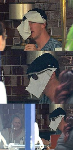 Benedict Cumberbatch trying to hide from paparazzi.