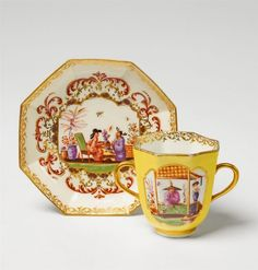An octagonal Meissen cup and saucer with finely painted chinoiserie scenes.  Blue crossed swords mark, saucer marked //. A fault in the clay to the rim of the cup, which has been repaired in the manufactory. The saucer with a short crack to the edge, slightly open to the reverse. H of cup 7.5 cm.   Ca. 1730 - 35, decor in the manner of Johann Gregorius Hoeroldt.