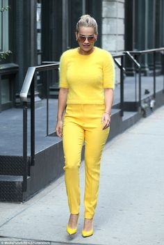 Head over heels: Rita completed her exhilarating look with a pair of sunny coloured pumps...