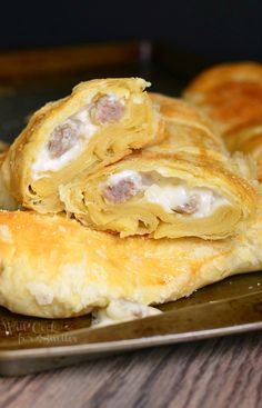 Wonderful weekend sausage and gravy breakfast treat. Comforting, flaky puff pastry filled with homemade white gravy and sausage.