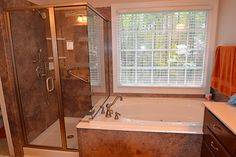 Granite bathroom. Granite shower, granite tub side by side. Looks like granite without the cost. Acrylic comes in a wide variety of patters without the cost.