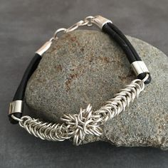 Sterling Silver Chainmaille Weave Bracelet Black Leather Bands and s closure end caps Sterling Silver Leather Chainmaille Bracelet Woven Bracelets, Gemstone Bracelets, Bracelets For Men, Fashion Bracelets, Sterling Silver Bracelets, Diamond Bracelets, Diamond Rings, Charm Jewelry, Wire Jewelry
