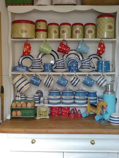Kitchen dresser-   a tiny bit chaotic for me but I love the Cornish blue Crockery on a pretty dresser.