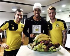 Henrikh Mkhitaryan, Pierre-Emerick Aubameyang, and Marco Reus pose with the new BVB Dortmund Cookbook :) #BVBDortmund