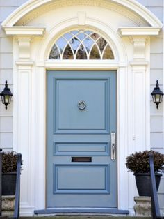 This soft shade highlights the true character of this colonial-style home. See more colorful doors >>