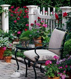 Dark green outdoor furniture, repeated in the barstools and dining set on the other terraces, avoids stealing the show from the colorful flora, instead playing a supporting role./