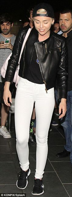 Bye, it's been fun! The Hannah Montana star was pictured leaving Barcelona on Saturday nig...