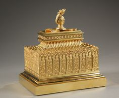 A large rectangular gilt bronze inkstand in Gothic style,  decorated with  cathedral arcade. The cover is adorned with a helmet and feathers, a shield and a sword, a symbol of...