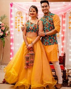 In Indian Weddings, the red bridal lehenga is most loved among brides. For ages, Indian brides have chosen red as the colour of their bridal trousseau. Brides are opting the Mango is the new red for brides this wedding. Couple Wedding Dress, Wedding Dresses Men Indian, Indian Bridal Outfits, Indian Gowns Dresses, Indian Designer Outfits, Indian Weddings, Wedding Couples, Shadi Dresses, Indian Bridal Fashion