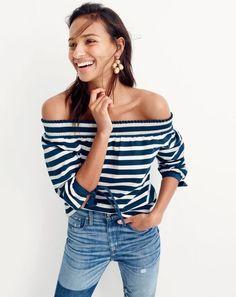J.Crew women's striped long-sleeve off-the-shoulder top, Point Sur Stevie x-rocker jean in Kirkby wash and jewel box cluster earrings.