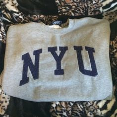 Grey NYU Sweatshirt Excellent condition grey collegiate sweatshirt with navy lettering. Only worn a couple of times-there's a name written on the inside of the collar (pictured), but no other visible wear (no stains or marks). I love this but it doesn't fit me anymore. Tops Sweatshirts & Hoodies