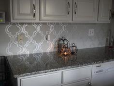 stencil backsplash using martha stewart opalescent paint. | home