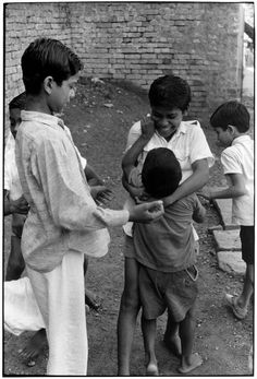 Boys playing in front of a brick wall.. From Duke Digital Collections. Collection: William Gedney Photographs and Writings. Mark: None. Date of print: Unknown.