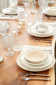 While Lauren keeps the servingware neutral, she makes it interesting by adding textured plates and glassware at varying heights, like these darling hobnail glasses from HomeGoods.