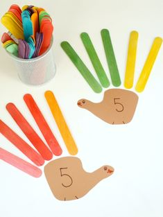 Turkey Feather Addition Thanksgiving Activity for Kids-Practice number pairs with this fun math game for kindergaten and first grade