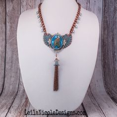 A personal favorite from my Etsy shop https://www.etsy.com/listing/231075906/bald-eagle-and-blue-cameo-statement