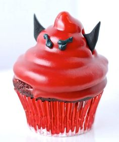 Red Velvet Devil's Food Cupcakes: These Red Velvet Cupcakes are topped with tasty cream cheese frosting and than dipped into red chocolate. What fun little devils!