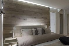 diy wall/headboard. i have some extra fake wood flooring lying around (what do you call that again? i cant think this morning) so i might put it to use and give this a shot.