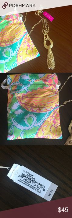 NWT Lilly Pulitzer gold tassel necklace Lily Pulitzer Fantasea gold tassel necklace. New with tags and includes beautiful patterned Lilly jewelry bag Lilly Pulitzer Jewelry Necklaces
