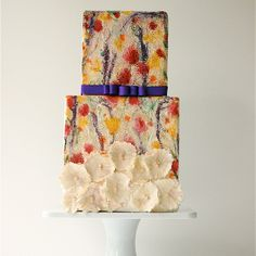 Stunning watercolor wedding cake with purple accent ribbon // Maggie Austin Cake
