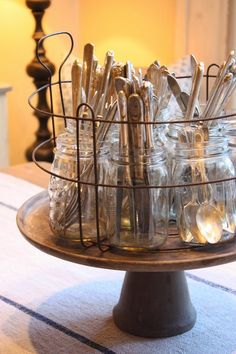 great way to store that flatware - vintage cake plate and mason jars