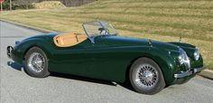 British racing green vintage Jaguar roadster. ...