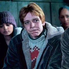 I think he's Fred Weasley... but how can we recognise them? ;)
