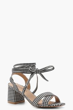 Click here to find out about the Jessica Gingham Cross Strap Ankle Wrap Heels from Boohoo, part of our latest Shoes collection ready to shop online today!